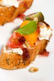 Tomatoes and cream cheese canapes Royalty Free Stock Photos