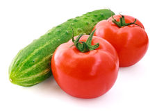 Tomatoes and cucumber. Fresh cucumber and tomatoes on white background stock photo