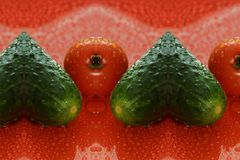 Tomatoes and cucumber on a red background water droplets on the. Tomatoes and cucumber on a red background with water droplets on the surface. green heart of stock photography