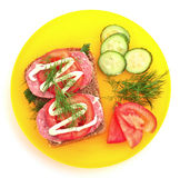 Tomatoes, cucumber and sausage on bread Royalty Free Stock Images