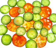 Tomatoes and cucumber -slices of vegetables Royalty Free Stock Photography