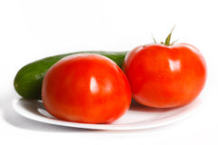 Tomatoes and cucumber Stock Photos