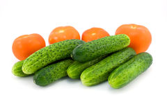 Tomatoes, cucumbers. Tomatoes and cucumbers isolated on white Royalty Free Stock Photography