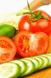 Tomatoes and cucumbers beautifully cut on the Boar Stock Photography