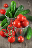 Tomatoes and cucumbers in buckets Stock Photography