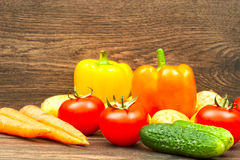 Tomatoes, cucumbers, carrots and potatoes Stock Images