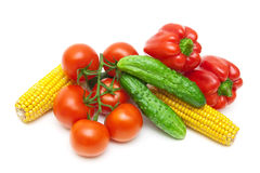 Tomatoes, cucumbers, corn and sweet peppers on a white backgroun Royalty Free Stock Photo