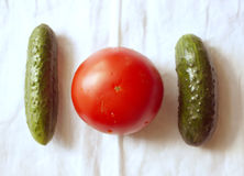 Tomatoes and cucumbers Stock Photos