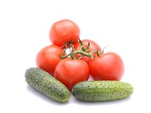 Tomatoes and cucumbers isolated on white backgroun Stock Photography