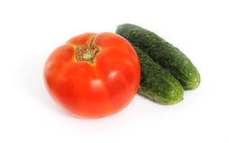 Tomatoes and cucumbers. Isolated on white background Stock Image
