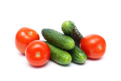 Tomatoes and cucumbers isolated on white background Royalty Free Stock Images