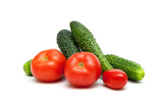Tomatoes and cucumbers isolated on white background. Royalty Free Stock Images