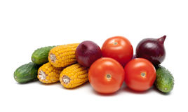 Tomatoes, cucumbers, onions and corn on a white background Stock Photos