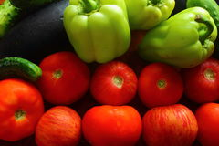 Tomatoes, cucumbers, peppers. Healthy diet with fresh tomatoes, cucumbers, peppers Royalty Free Stock Images