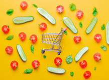 Tomatoes and cucumbers with shopping cart Stock Photos