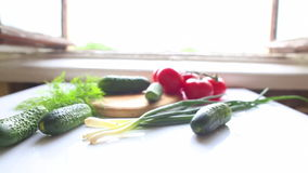 Tomatoes and cucumbers on the table in kitchen stock footage
