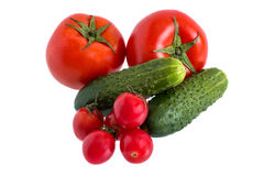 Tomatoes and cucumbers Stock Image