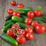 Tomatoes and cucumbers on wood Stock Photography