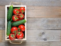 Tomatoes and cucumbers in wooden box Royalty Free Stock Photography