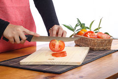 Tomatoes. Cut by a kitchen knife on a wooden board Royalty Free Stock Photos