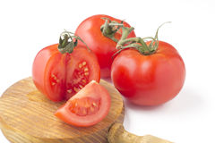 Tomatoes cut wood Stock Photography