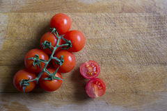 Tomatoes on cutting board. Cherry tomatoes on wooden cutting board Royalty Free Stock Images