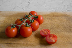 Tomatoes on cutting board. Cherry tomatoes on wooden cutting board Royalty Free Stock Photos