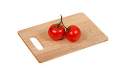 Tomatoes on a cutting board on an isolated background top view Stock Photography