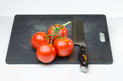 Tomatoes  on Cutting Board Royalty Free Stock Photo