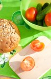 Tomatoes on the cutting board with rye bread Stock Images