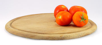 Tomatoes on a cutting board wooden Stock Images