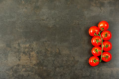 Tomatoes on dark copy space Royalty Free Stock Image