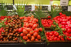 Tomatoes in the department store. Large tomatoes display in the department store, Paris, France Stock Images