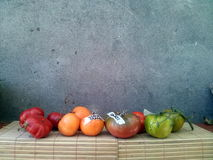 Tomatoes 22. Different types of tomatoes on wooden shelf Stock Photo