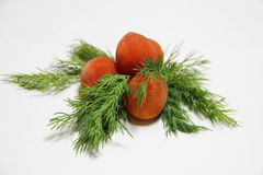 Tomatoes with dill. Frozen cherry tomato with dill on a plate Stock Photos