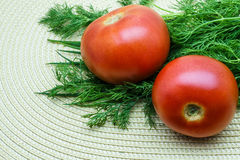 Tomatoes and dill on a napkin. Tomatoes and dill on a wicker napkin stock images