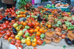 Tomatoes on display in the market stock image