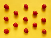 Tomatoes dots on yellow background Royalty Free Stock Image