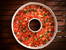 Tomatoes in drier. Stock Photos