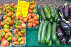 Tomatoes, eggplant and zucchini for sale. At a market Royalty Free Stock Photos