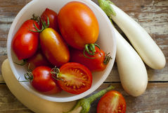 Tomatoes and Eggplants Stock Images