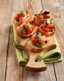 Tomatoes, eggplants and parsley crostini Royalty Free Stock Photography