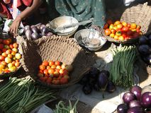 Tomatoes and eggplants  for sale in weekly market Stock Photography