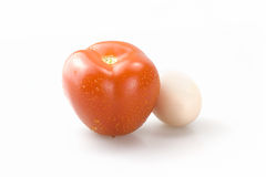 Tomatoes and eggs. A tomato and an egg together Royalty Free Stock Photo