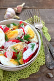 Tomatoes and eggs salad Stock Images