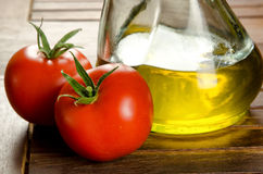 Tomatoes and extra virgin olive oil Stock Photography