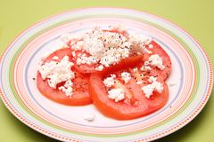 Tomatoes with feta cheese Royalty Free Stock Image