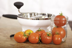 Tomatoes with Food Mill. And canning jar fresh from the garden Royalty Free Stock Photography