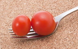 Tomatoes on the fork Stock Images