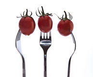 Tomatoes on Forks Royalty Free Stock Photography